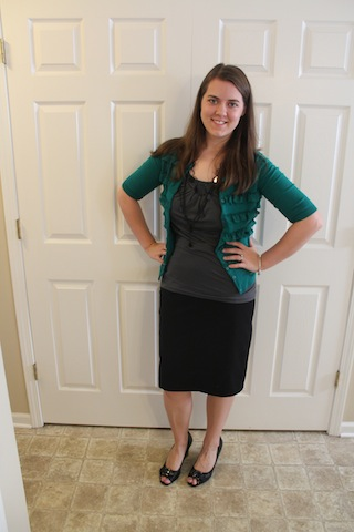 black pencil skirt, gray top, green ruffled cardigan