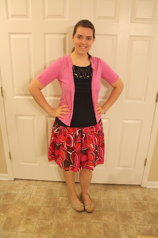 red floral skirt, navy top, pink cardigan