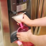 How to fill a narrow-mouthed water bottle using a fridge dispenser {Works for Me Wednesday}