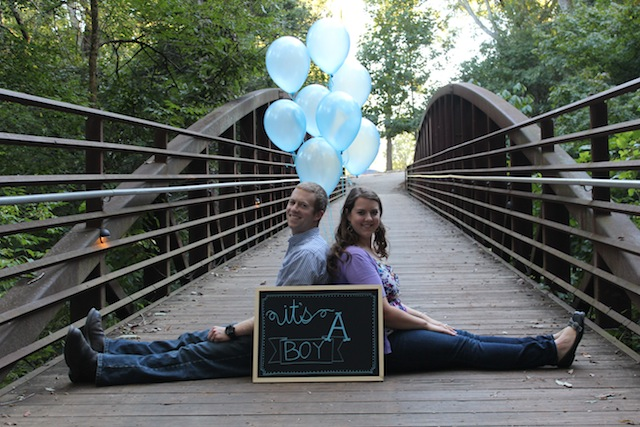 gender reveal with balloons and sign
