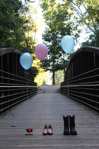 gender reveal with balloons tied to shoes