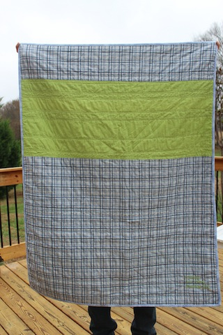 navy and green baby quilt back