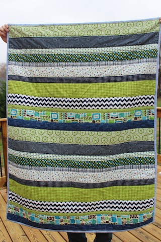 navy and green baby quilt front