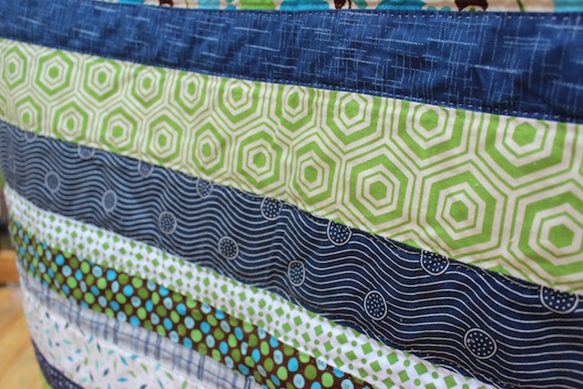 navy and green baby quilt stripes