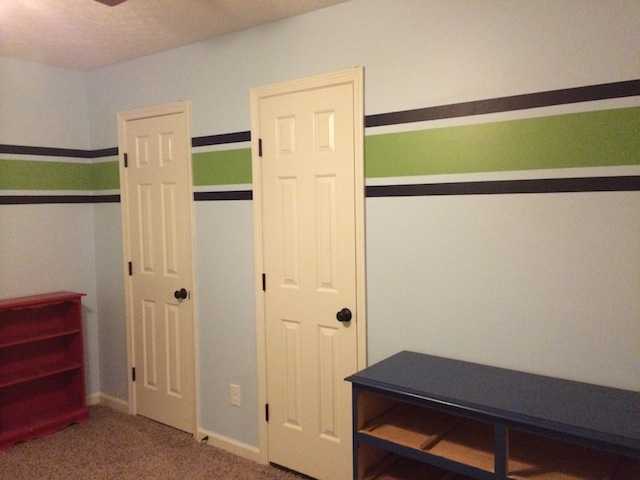 navy and green stripe in nursery