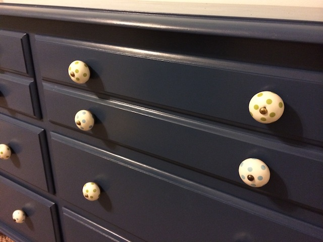 navy dresser with polka dot knobs