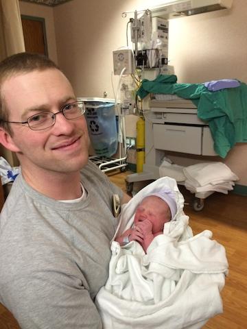 Daddy holding Hudson
