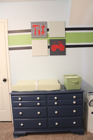 green and blue nursery changing station