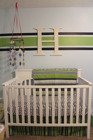 green and navy nursery crib