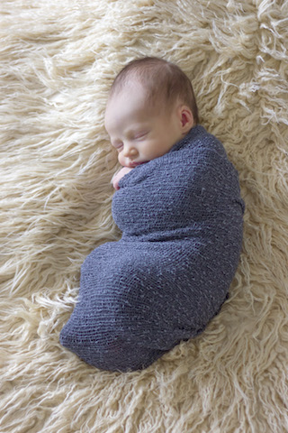newborn pictures - gray swaddle