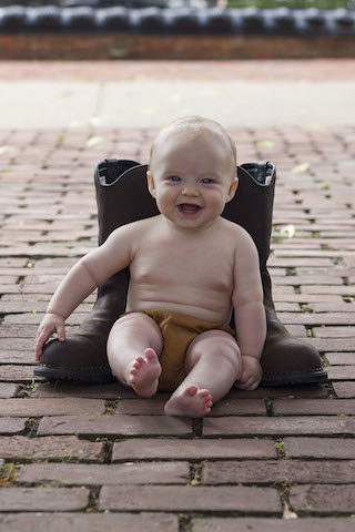 6 month pictures with carhartt diaper cover and boots