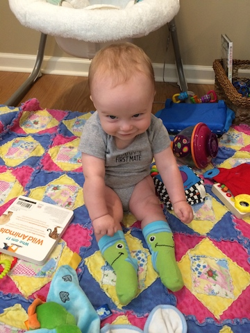 mischievous grin and frog socks