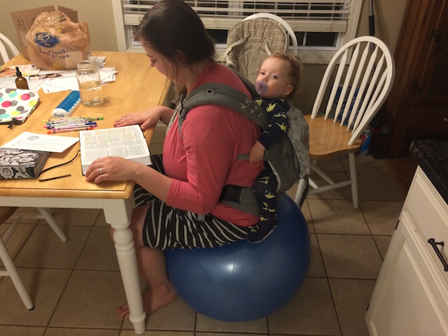 babywearing on an exercise ball