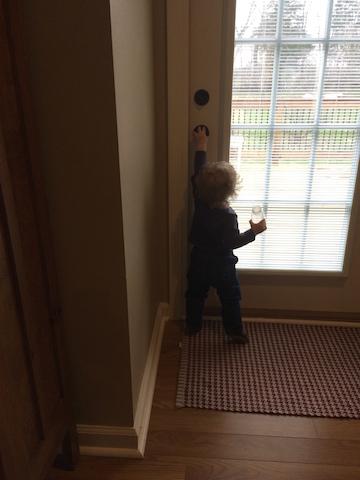 reaching for doorknobs