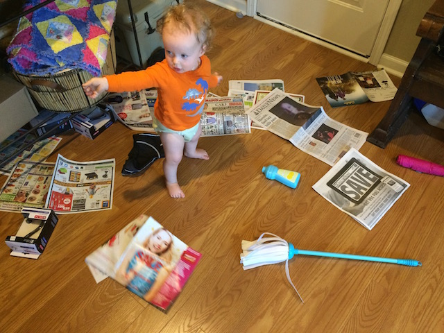 playing with the newspaper