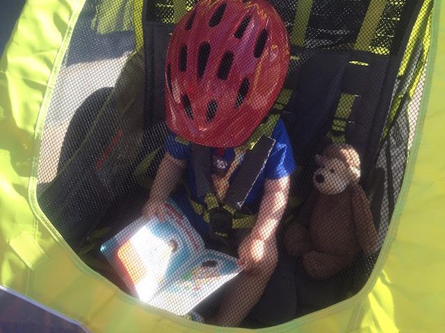 reading in the bike trailer