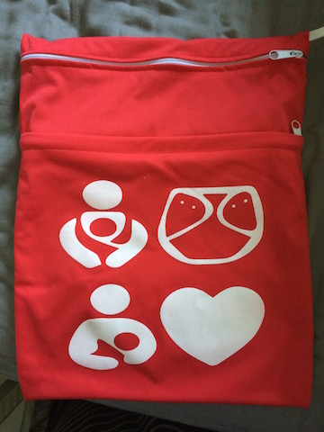 cloth diaper wet bag with babywearing and breastfeeding symbols