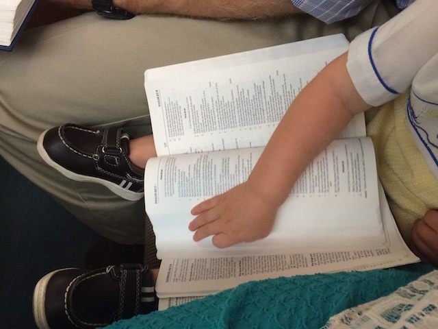 reading Daddy's waterproof Bible