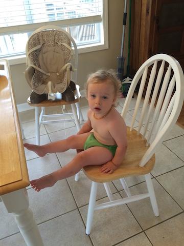 climbing into a chair