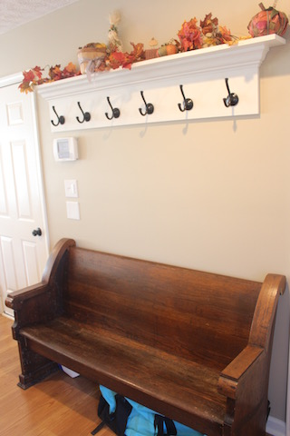 church pew and hooks