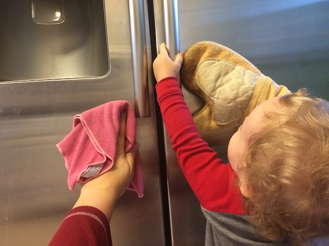 helping clean the fridge