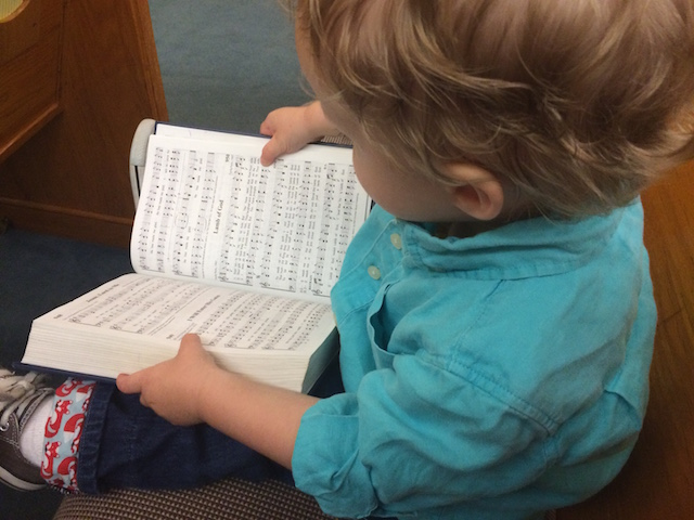 reading the songbook at church