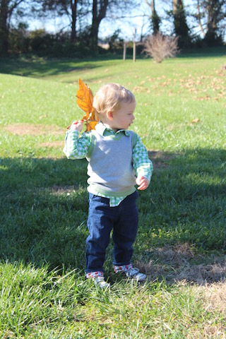 playing with a leaf outside