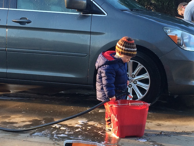 helping Daddy wash the van