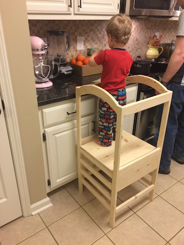 toddler tower for child to stand on in the kitchen