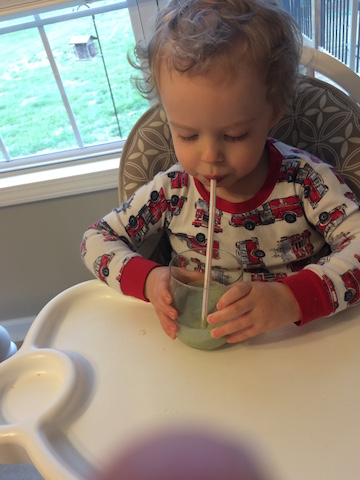 drinking a green smoothie