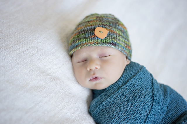 newborn pictures swaddled with a hat