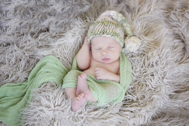 newborn pictures wrapped up with a hat