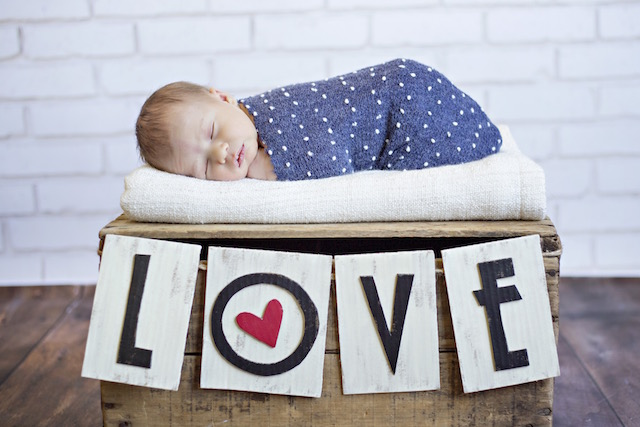 newborn pictures with love sign