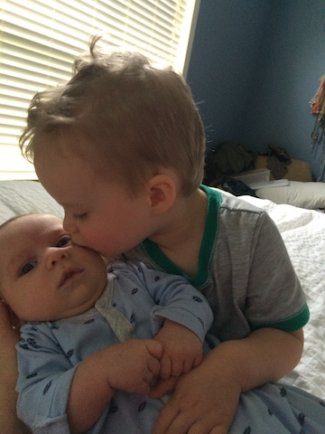 brother kisses
