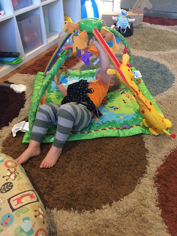 playing on the play mat