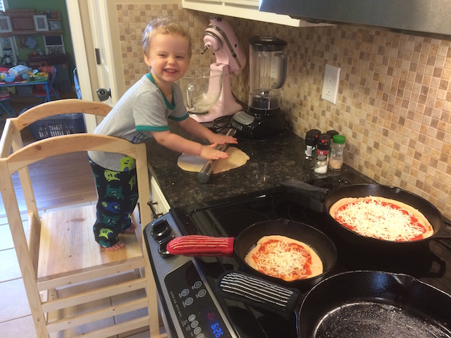 rolling out pizza with Daddy