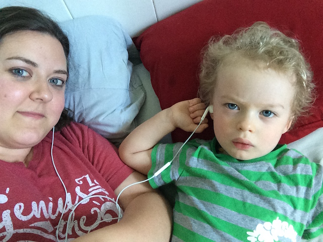 sharing headphones while mommy listens to a webinar