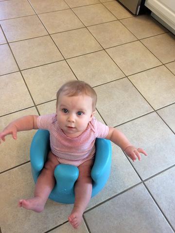 sitting in the Bumbo seat