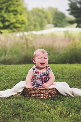 6 month pictures in a basket crying