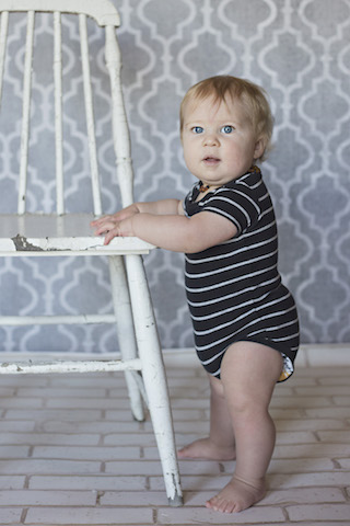 9 month pictures with a distressed white chair