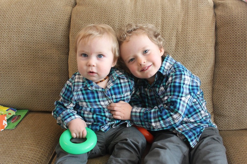 brothers in matching Carter's outfits