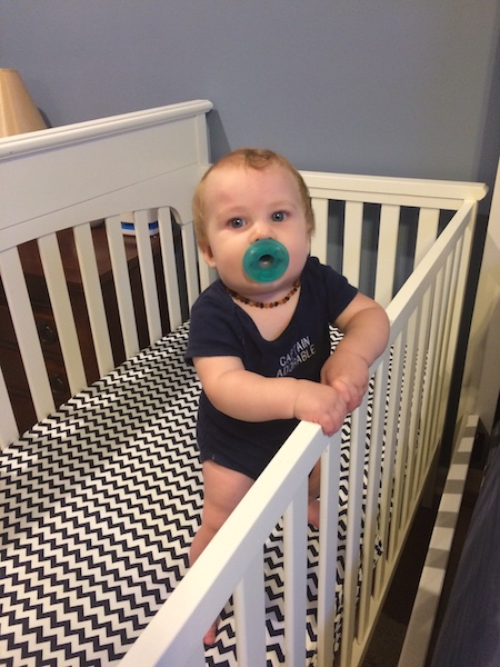 standing up in his crib