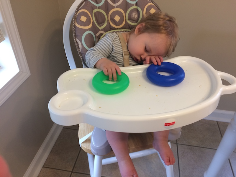 asleep in his high chair