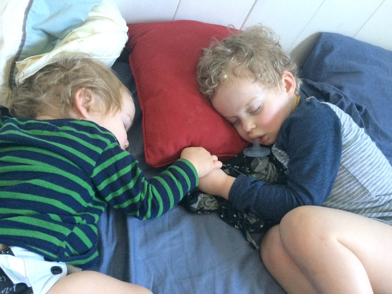 brothers sleeping and holding hands