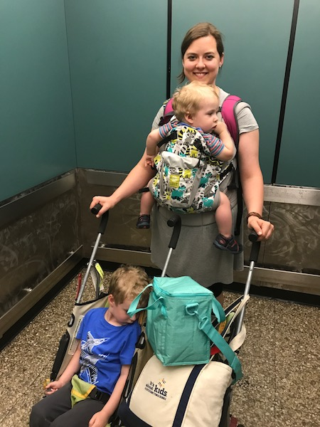 babywearing and double stroller at the airport