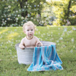 Parker's 18 month pictures: bathtubs and bubbles