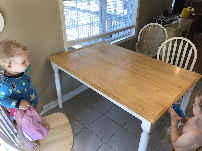 cleaning the kitchen table